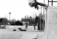 Gabe chode saxon crail slide on the vert wall at Mira Loma skatepark
