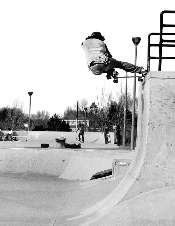 Gabe chode saxon crail slide on the vert wall at Mira Loma skatepark