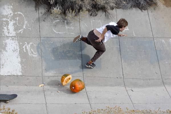 Mitch Haight slicing pumpkins..